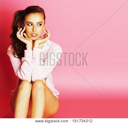 young cute disco girl on pink background smiling adorable emotions, lifestyle people concept close up