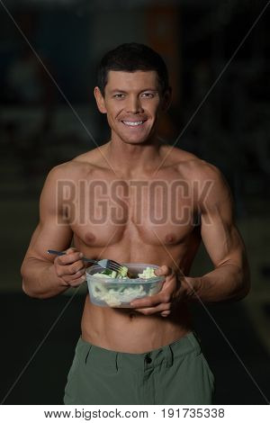Proper Nutrition Concept, Athlete With Vegetables