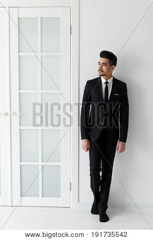 Confident Businessman In Black Suit Standing Full-length