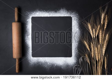Baking Utensils And Flour With Whisk And Rolling Pin