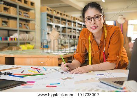 Fashion Designer Sketching Design