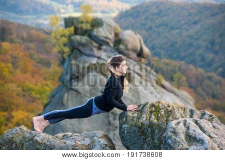 Peaceful Fit Woman Is Practicing Yoga And Doing Asana Urdhva Mukha Shvanasana On The Top Of The Moun