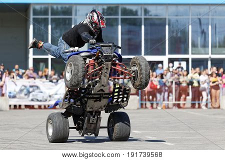 A Motorcycle Rider Make Wheelie On The Atv