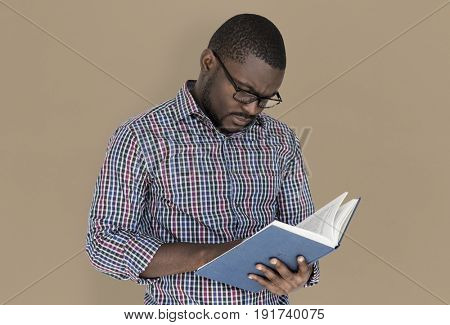African descent man is reading a book