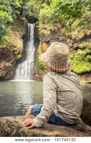 Child looking Chamouze waterfall. Mauritius island