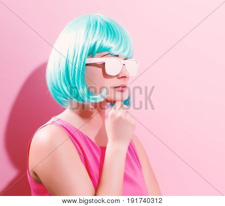 Portrait Of A Woman In A Bright Blue Wig