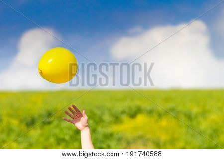 playing with ballon in the fields at spring, freedom concept