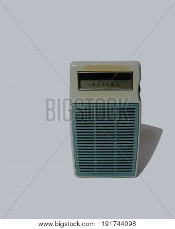 An antique transistor radio on a white background