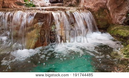 Artificial small waterfall with a beautiful decoration