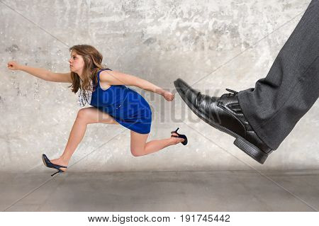 Small businesswoman running away from a boss pressure - big boss concept