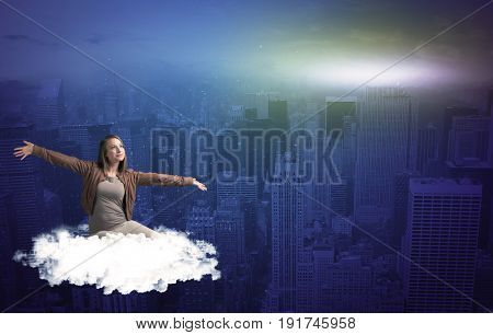 Caucasian woman sitting on a white fluffy cloud above the big city wondering