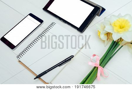 Top View On Table With Narcissus, Empty Diary, Pencil, Tablet And Phone, Free Space, White Screen. Y