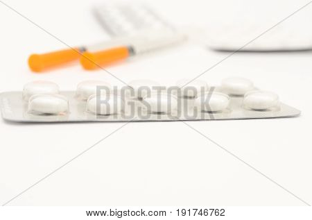 Contraceptive tablets in packages and without on a light background. Preparations of medical purpose.