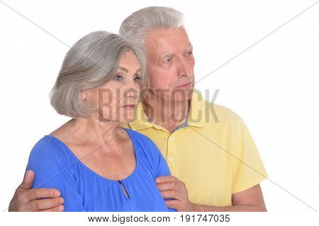 Portrait of sad senior couple isolated on white background