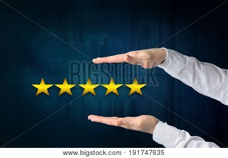 Quality performance review evaluation and classification ranking concept. Protecting gesture of businessman and symbols of five yellow glowing stars icons in the foreground.