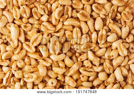 Puffed honey air rice wheat closeup background. Cereals texture.