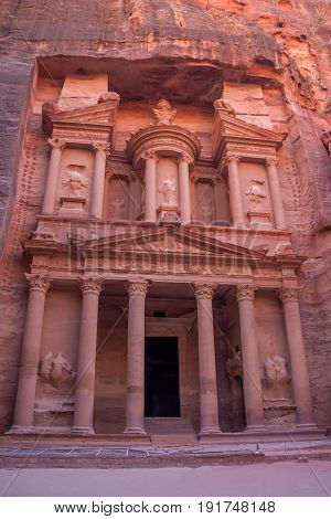 Scenic view to facade of famous tomb Al-Khazneh or Treasury in Petra, Jordan