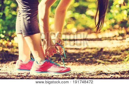 Female runner preparing to go for a jog outdoors