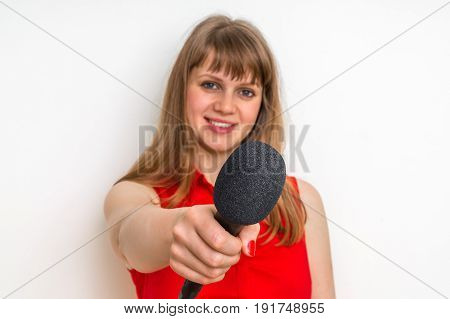 Portrait Of Female Reporter With Black Microphone
