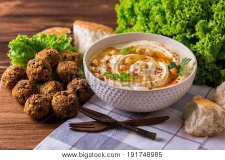 Hummus, Falafel And Chickpea Served With Salad And Pita