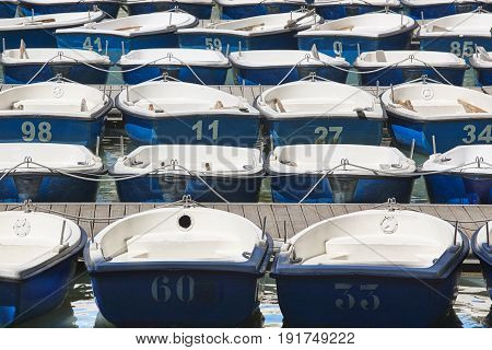 Rowing boats to rent in a pond. Summer background. Spain