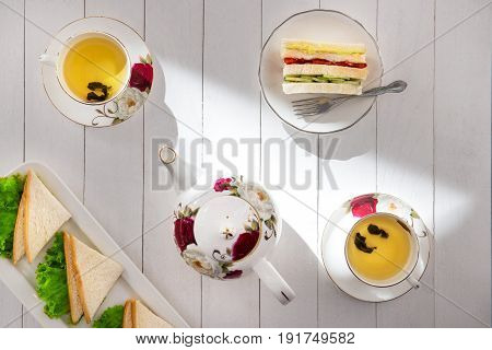 Afternoon Tea Table. Tea Set With Sandwiches