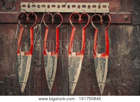 Antique scissors hang on the door. Antiques of Greece and Cyprus