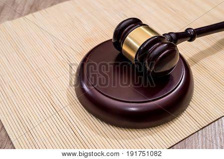 Wooden Judge Gavel  On Desk, Close Up