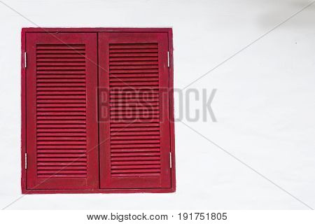 The Red window on white wall for ackground