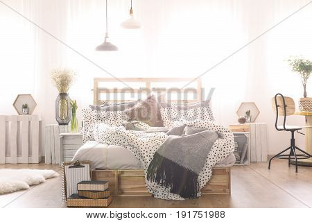Bedroom with DIY double bed lamp wooden chair and window