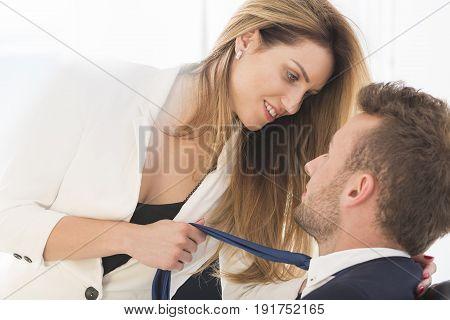 Elegant beautiful business couple having affair at work