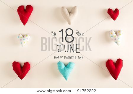 Father's Day message with blue heart cushions on a white paper background