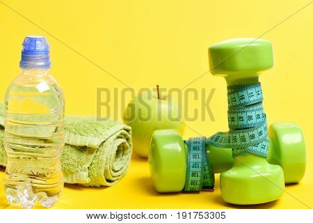 Sports And Diet Set: Bottle With Water, Towel, And Apple