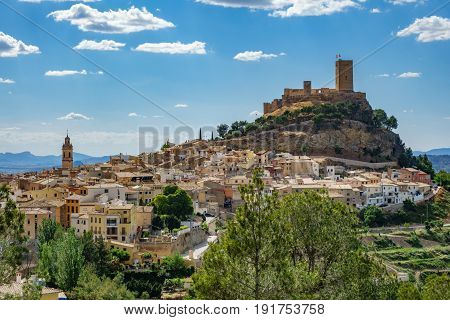 Top of the hill with Biar castle and town at dusk in Alicante, Spain