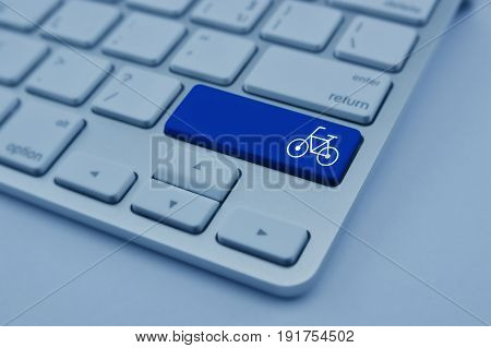 Bicycle flat icon on modern computer keyboard button Business internet service bike concept
