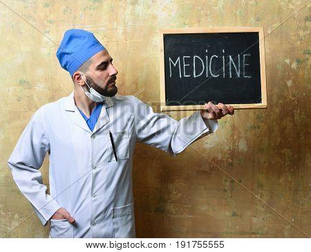 Medicine Word Written On Blackboard Which Is Held By Doctor