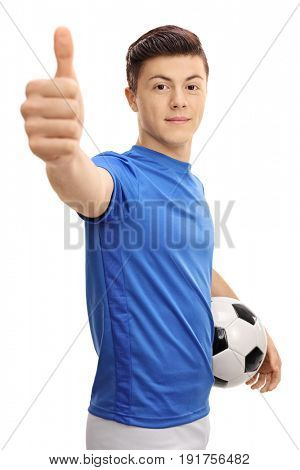 Teenage soccer player with a football making a thumb up gesture isolated on white background