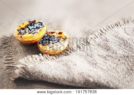 Pastel de nata portuguese traditional creamy pastry. Egg Tart with cinnamon close up