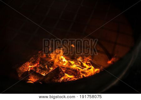 Fire flames on black background - barbecu fire place with copy space