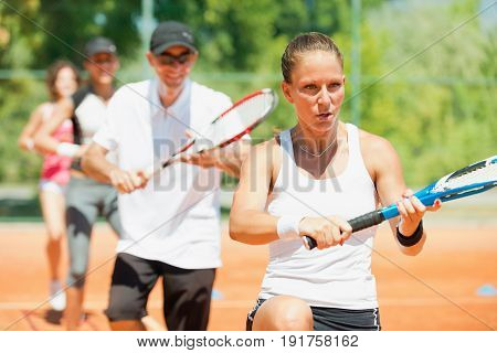 Intensive cardio tennis training outdoors, color image