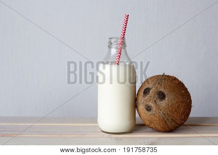 Fresh Organic Vegan Coconut Milk In A Bottle With Cocktail Straw