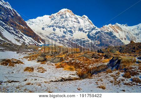 Snow Mountain Landscape in Himalaya. Annapurna South peak and mountain stream. Nepal, Annapurna Base Camp Track.