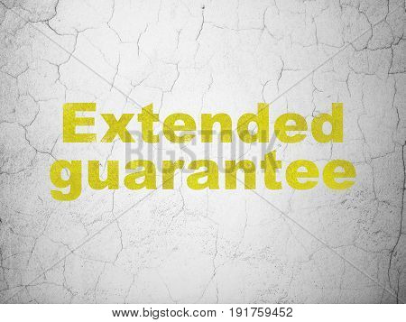 Insurance concept: Yellow Extended Guarantee on textured concrete wall background
