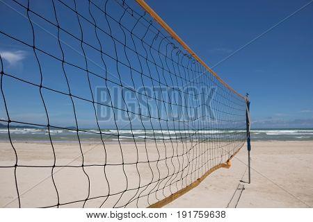 blue sky through beach volleyball net on the beach