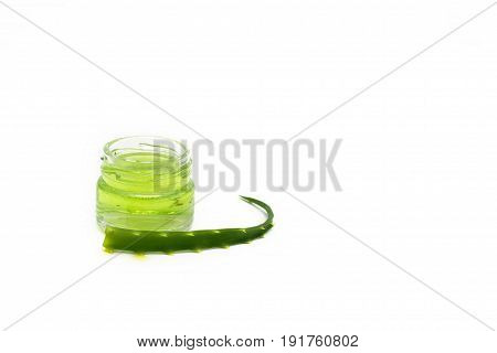 aloe vera gel in a small jar and small aloe leaf copy spase