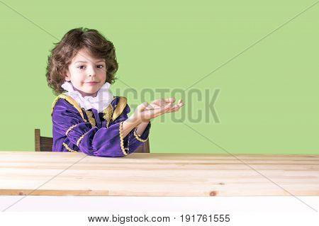 Small Mod In Prince Clothes Cute Smiling Holding Hands On Bent Imaginary Thing, Looking At The Camer