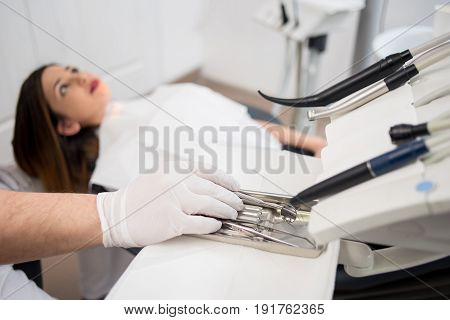 Dentist With Gloved Hands Is Treating Patient With Dental Tools In Dental Hospital. Dentistry. Selec