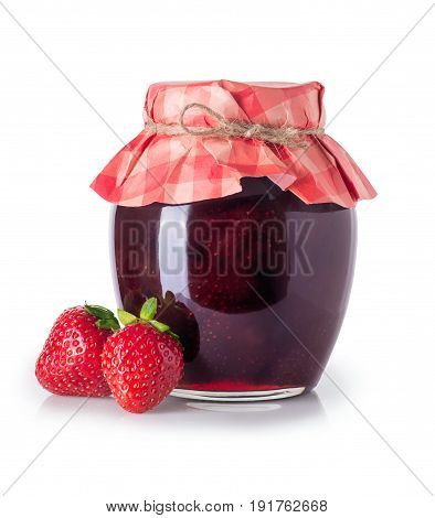 Strawberry jam. Glass jar of strawberry jam and fresh berries near isolated on white background. Preserved fruits. Homemade strawberry jam in jar covered with paper