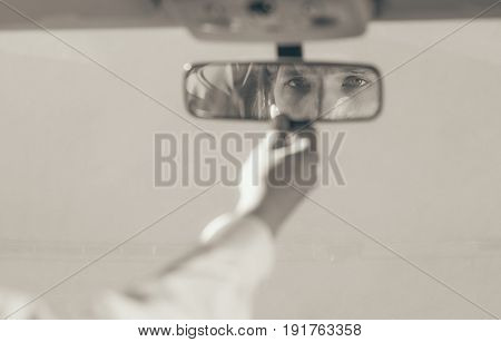 Man In Car Looking At Mirror Inside