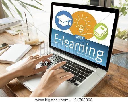 hand typing on computer keyboard with E-learning Education on screen. internet online study concept.